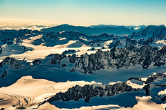 Looking down at the vastness of the snow covered New Zealand Southern Alps from a Helicopter (stewart.watsonnz) Tags: snow mountain nature glacier ice winter landscape mountainrange outdoors sky skiing hill wilderness slope valley cloud mountainouslandforms outdoor noperson travel glaciallandform man peak naturallandscape covered scenery sunset gear high alps standing massif land lake large aerialview water ridge people panoramic dawn cold scenic icecap rock new zealand southern aoraki mount