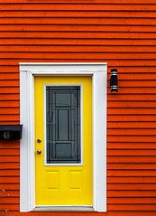 Yellow Door, Red House (Karen_Chappell) Tags: red yellow white door trim wood wooden nfld home house downtown paint painted clapboard window jellybeanrow newfoundland stjohns canada canonef24105mmf4lisusm eastcoast avalonpeninsula atlanticcanada city urban black mailbox post mail geometry geometric architecture building rowhouse bright colour color colours colors colourful