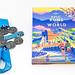Epic runs of the world von Lonely Planet: Marathon-Medaillen neben einem Laufstrecken-Buch für Sportler, vor weißem Hintergrund