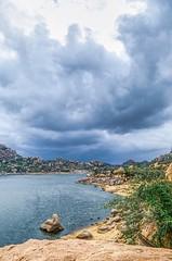 The coming storm... (Kashish Bhatia) Tags: warm blue cliff hail overcast hills water deccan exposure multiple hdr landscape hampi lake plateau rock rain monsoon storm clouds nature