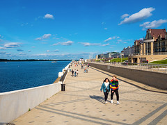 Nizhny Novgorod. Embankment (Oleg Danin) Tags: volga nizhnynovgorod city russia cityscape river summer ship coast building street roof girl people olympus clouds sky landscape outside outdoors town houses water