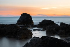 Sunset in the mist (uluqui) Tags: fuji fujifilm longexposure mist capdagde agde coast beach sea water landscape paysage twilight outside sun sunset shore wanderlust adventure nature france art sky light rock roche