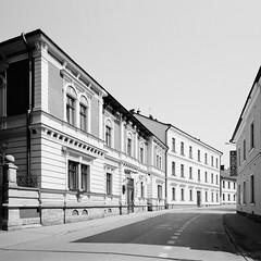 Tarnów city (fotoswietokrzyskie) Tags: city tarnów poland building architecture medium format 6x7 analog mamiya 7ii kodak tmax400 monochrome blackandwhite road street