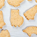 Cookies in the shape of animals on a white background. Top view