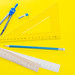 Drawing kit-ruler, compass and pencil on yellow background