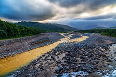 Yellow river in Costa Rica (FVillalpando) Tags: river landscape clouds costarica stones sunset places tropic water
