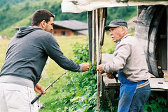 Fishing (auqanaj) Tags: analog film meinfilmlab wwwmeinfilmlabde ladurns südtirol southtyrol altoadige fishing angeln forelle trout teich pond lake bergsee people alpen alm alps nikonafnikkor85118d nikonf100 nature
