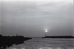 Setting Sun (H.Treuth) Tags: sunset bank lighthouse aeroplane sea port 35mm nikkor fm2 agfaapx100 blackandwhite bw landscapephotography rodinal tamsui taiwan