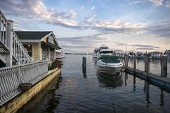 Mackinac Island (DJ Wolfman) Tags: mackinacisland michigan michiganfavorites water boats clouds dock upnorth yellow blue sky sunset harbor olympus olympusomd em1markii zuiko 1240mmf28 zd