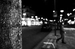 A shining face (stefankamert) Tags: shining face lights night bokeh blur blurry street city balingen people stefankamert ricoh gr grii ricohgr tree textures grain noir noiretblanc blackandwhite blackwhite bw