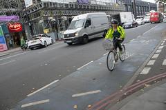 DSC_6113 London Bus Route #205 Whitechapel Cyclist (photographer695) Tags: london bus route 205 whitechapel cyclist