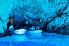 Tourists in the Blue Cave on Bisevo island, Croatia
