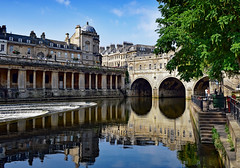 Pulteney Bridge Reflections (Jocelyn777) Tags: water bridges buildings architecture monuments waterreflections reflections arch trees foliage bath england