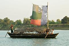 Boat with damaged sail on the Lemyo River (or Lemro) - Myanmar (PascalBo) Tags: nikon d70 burma birmanie myanmar asia asie southeastasia asiedusudest rakhinestate lemro lemyo river rivière boat bateau man woman femme homme outdoor outdoors pascalboegli