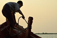 Sailor handling a rope on a boat in Rakhine State - Myanmar (PascalBo) Tags: nikon d70 burma birmanie myanmar asia asie southeastasia asiedusudest rakhinestate river rivière boat bateau sunset coucherdesoleil rope corde outdoor outdoors pascalboegli