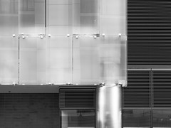 Glass Panels (Nick Condon) Tags: abstract architecture blackandwhite brick building chicago glass metal olympus45mm olympusem10 reflection urban vent wall
