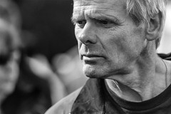 Face of character (Frank Fullard) Tags: frankfullard fullard candid street portrait face expression closeup black white blanc noir monochrome jaw lean athletic spartan athlete castlebar tugofwar mayo irish ireland character hardyboy handsome
