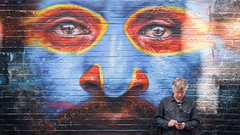 Spacial Awareness (Julian Heritage) Tags: dalegrimshaw streetart streetphotography streetscene bricklane hanburystreet candid person texting city urban art artwork mural text mobile