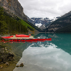 Fancy a paddle? (10000 wishes) Tags: lake water reflections beauty mountains canoes redcanoes canada outdoors travelphotography nature naturallight scenic therockies