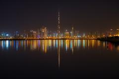 Split World (|MBS-..|) Tags: fujifilm reflection cityscape night dubai downtown burjkhalifa architecture city light