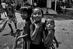 Poor but Happy (3MY MAIK3) Tags: manila cemetery children philippines happy blackandwhite journey walktoshot