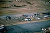AMARC Apr 99 (2) (Al Henderson) Tags: 148320 148321 amarc arizona aviation c130 c141 davismonthanafb hercules lc130 lc130f lockheed starlifter tuscon usaf vxe6 boneyard desert military storageusaf