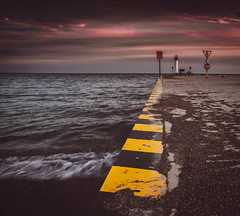 The Edge (ryce.davd) Tags: pier whitby durham chevron colourful canada ontario lake sunset sky lighthouse purple waves gravel signs