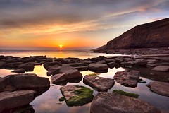 Stepping stones at sunset (Ade Ward Phototherapy.) Tags: tranquility outdoors d7200 nikon seascape seaside landscape dramatic clouds heritagecoast dunravenbay tide ocean rocks steppingstones sunset