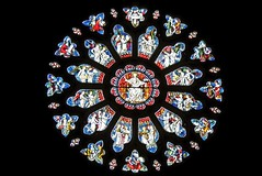 Circle of Light (Kevin Pendragon) Tags: stained glass colours light dark images religion cathedral indoors photograph photo photography red blue yellow orange white