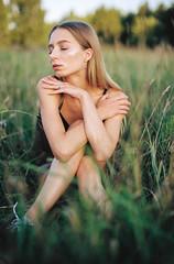 Ugne (Justin Takes Pictures) Tags: girl portrait film analog 35mm kodak colorplus 200 bokeh grain grass summer blonde evening