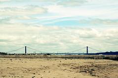 Mad Max EU (tamasmatusik) Tags: madmax dystopia muted mutedcolors lisbon cruzquebrada bridge beach sand sky clouds praiadecruzquebrada sony sonynex nex6 25deabrilbridge ponte25deabril lisboa portugal 83mm suspensionbridge june city