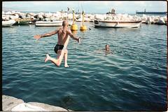 (Embrace Me) (Robbie McIntosh) Tags: leicamp leica mp rangefinder streetphotography kodak 35mm film pellicola filmisnotdead analog analogue negative kodakportra160 leicam summicron f2 leicasummicron35mmf2iv analogico leicasummicron35mmf20iv summicron35mmf20iv strangers sconosciuti beach sea spiaggia mare candid physique tan bellinifotoc41 c41 dyi homedevelopment selfdevelopment summer summertime woman man