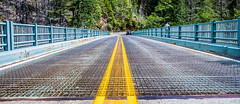 2019 - Road Trip - 1 - Gorge Creek Hwy 20 (Ted's photos - Returns 23 Sept) Tags: 2019 cropped nikon nikond750 nikonfx tedmcgrath tedsphotos usa vignetting cans2s gorgecreekbridge gorgecreekoverlook bridge yellowline yellowcenterline yellowcentreline washington washingtonstate northcascadeshighway hiway20 hwy20 railing bridgedeck wideangle widescreen street road roadway perspective roadtrip 2019roadtrip hiway yellow line driveway vehicle converging rust rusty arrow