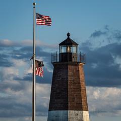 Port Judith  LIghthouse (Fiona Katarina) Tags: lighthouse seaside olympus oceanview getolympus fkimages newengland flags rhodeisland portjudith