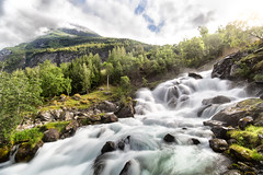 Morning Sun Over Geiranger (jamesromanl17) Tags: geiranger norway scandinavia fjord water waterfall sun sunlight morning light landscape landscapes unesco mountain mountains forest trees river falls valley hike hiking walk walking sky skies rocks stream sunny clearing