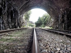 Rail Tunnel (Hammerhead27) Tags: tracks wales perspective olympus view lowpov unused derelict curve arch tunnel rail line railway industrial old welsh southwales machenquarry