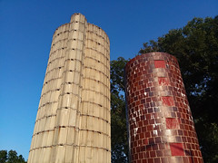 Silos With Blue Skies. (dccradio) Tags: lumberton nc northcarolina robesoncounty northeastpark penningtonathleticcomplex raymondbpenningtonathleticcomplex outdoor outdoors outside samsung galaxy smj727v j7v cellphone cellphonepicture saturday weekend saturdayevening evening goodevening saturdaynight citypark park sky eveningsky bluesky tree trees foliage greenery branch treebranch branches treebranches treelimb treelimbs ag agricultural silo silos