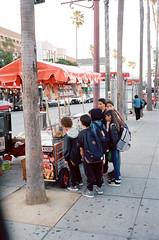 Churro Time! (Mo's Photos) Tags: analog analogphotography pas pointshoot filmphotography 35mm color amateurphotography streetphotography streetshooting streetphotos urban suburban grainisgood filmisnotdead shootfilmstaybroke candid random fun streetstalk kodakportra400 400iso fujifilmklasses fujifilm fuji klasse rolleiafm35 calle24 missiondistrict sanfrancisco lamision streetvendor lifeinthecity