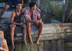 A6400569 v2 (Wheels Down) Tags: friends fip fireislandpines harbor sunset sitting shorts legs arms feet barefeet handsome guys males tanktop seawall knees