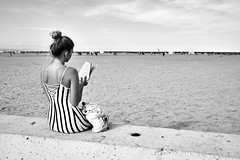 On reading (Alberto-Gómez) Tags: valencia playa beach book onreading reading malvarrosa streetphotography fujifilm