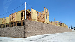 (Rich T. Par) Tags: pomona phillipsranch socal southerncalifornia losangelescounty lacounty constructionsite california suburb civilengineering house plywood lumber architecture brickwall fence driveway sky framework