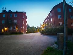 Welcome to my block (Niles Herman) Tags: dawn sunrise brick buildings red redbrick gubbängen stockholm asphalt light shadows outside