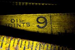 Nine Inch Mark (donjuanmon) Tags: donjuanmon nikon macro macromondays hmm wood ruler folding 9 nine 1933 yellow black lines