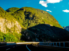 Western Julian Alps (Theirion) Tags: italy friuliveneziagiulia chiusaforte huawei huaweip10 lightroom green blue gold sky montains clouds nature landscape trees julianalps road smartphonephotos