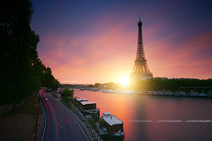 Sunrise behind the Eiffel Tower - Paris / France (Yannick Lefevre) Tags: europe france paris paysage sunrise landscape cityscape longexposure light urbanlight clouds sky sun pink yellow starlight sunlight boat river seine eiffeltower toureiffel quayside quai fleuve morning matin levédesoleil poselongue road nikon nikkor tripod ndfilter national cielo design purple flickr colors