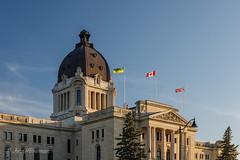 Flags in Golden Hour Light (John H Bowman) Tags: canada flags regina saskatchewan canadianflag britishflag wascanacentre canon24704l warmsunlight saskatchewanflag saskatchewanlegislativebuilding stateorprovincialcapitols july 2019 july2019 blueskywispyclouds