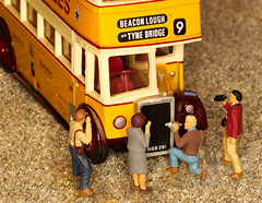 The photographers were very pleased to find an old no. 9 bus and snapped away contentedly! (alisonhalliday) Tags: nine macro yellow modelbus miniaturevehicle newcastlecorporation efemodel canoneos77d littlepeople miniaturepeople macromondays sigma105mm cmwdyellow cmwd colorfulworld
