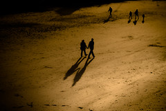Hand in hand (tonguedevil) Tags: outdoor outside seaside coast beach sand people walking golden colour light shadows sunlight sunset