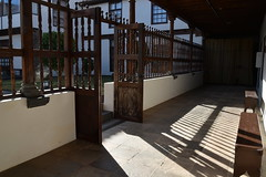 light and shadow and benches (Hayashina) Tags: tenerife lalaguna spain light shadow bench door fence corridor hbm