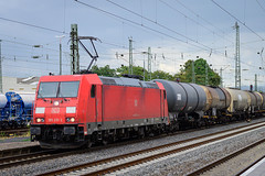 Deutsche Bahn 185 210 with a cargo train seen in Neuwied, Germany (Martin Bärtges) Tags: colorful farbenfroh grau grey waggons tank güterzug cargo deutschland germany neuwied zugfotografie trainspotting sommer summer bewölkt wolkig wolken clouds cloudy nikonfotografie nikonphotography mirrorless z6 nikon outdoor outside outstanding br185 rot red deutschebahn db bahn züge zug drausen trainspotters train